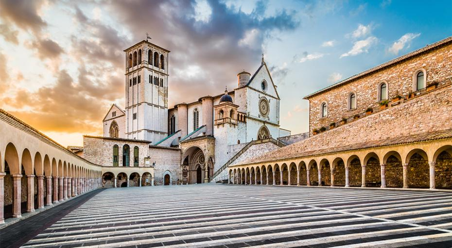 Famous Basilica of St. Francis of Assisi (Basilica Papale di San Francesco) with Lower Plaza at sunset in Assisi, Umbria, Italy.— Photo by pandionhiatus3
