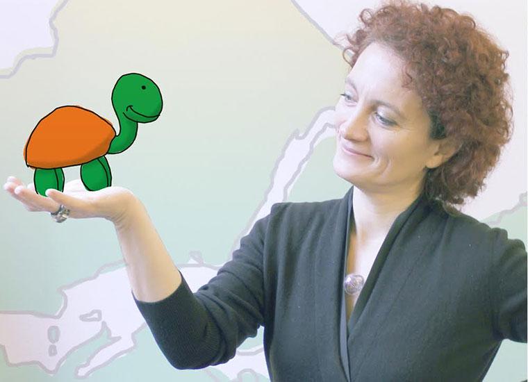 Chiara Burberi with Redooc's logo